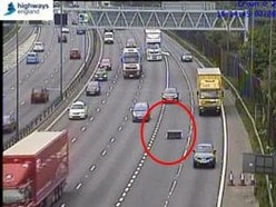 Life in the fast lane: Drivers dodge sofa on the M6