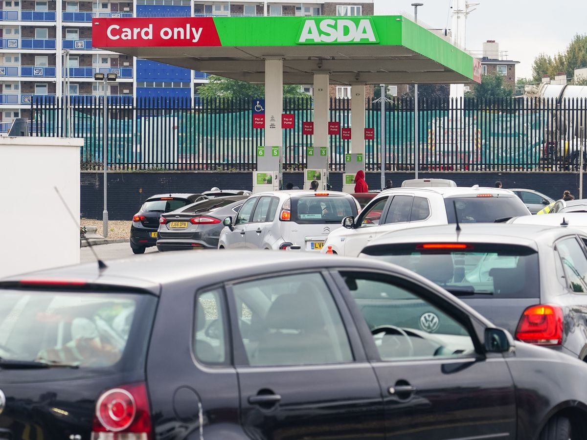 Cars queue for fuel at an Asda petrol station in south London amid continued panic buying