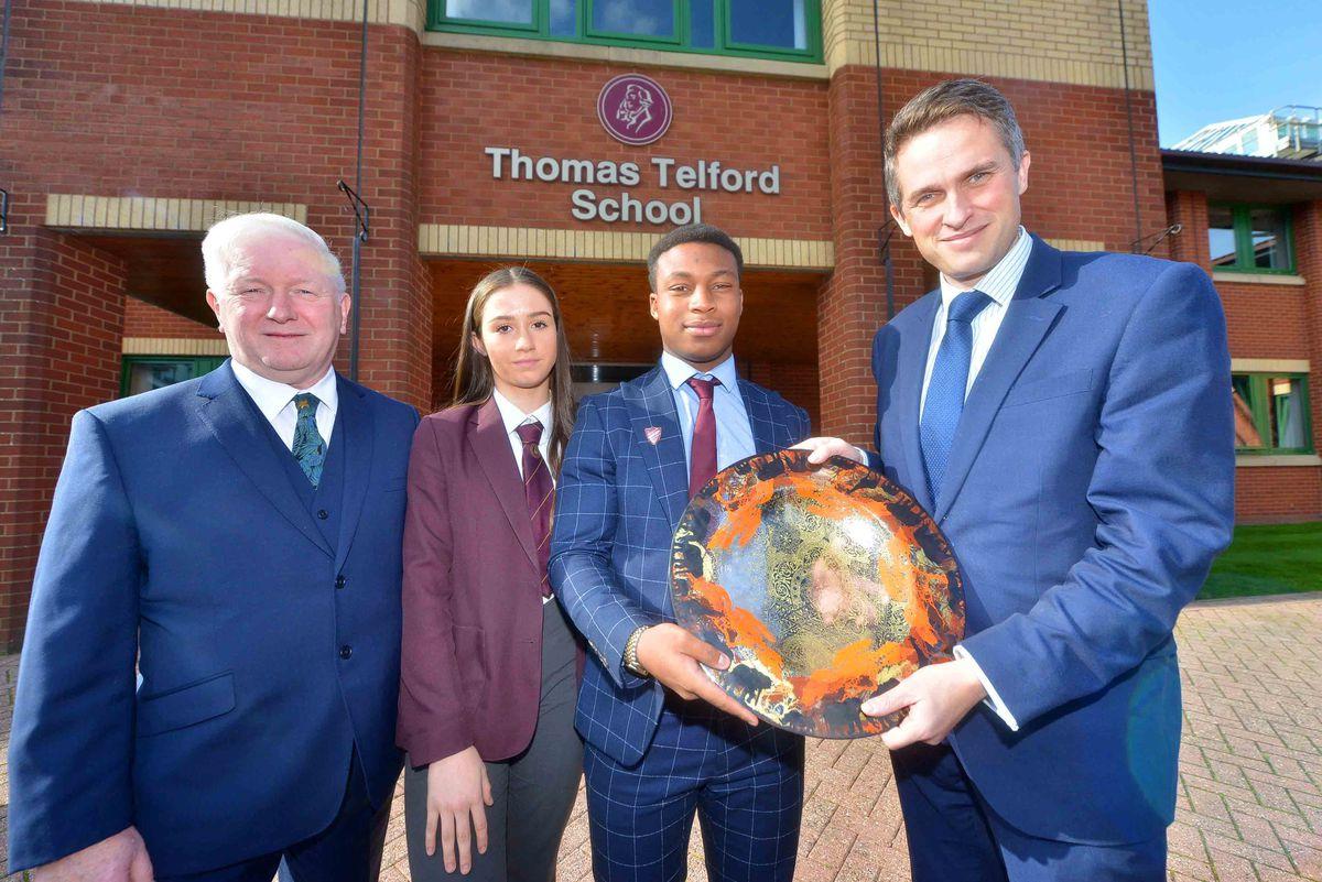 Thomas Telford headmaster Sir Kevin Satchwell, Rosie Brice, 13 and Gareth Effion, 17 present Education Secretary Gavin Williamson with a piece of glass art made by Much Wenlock artist Jane Murphy..
