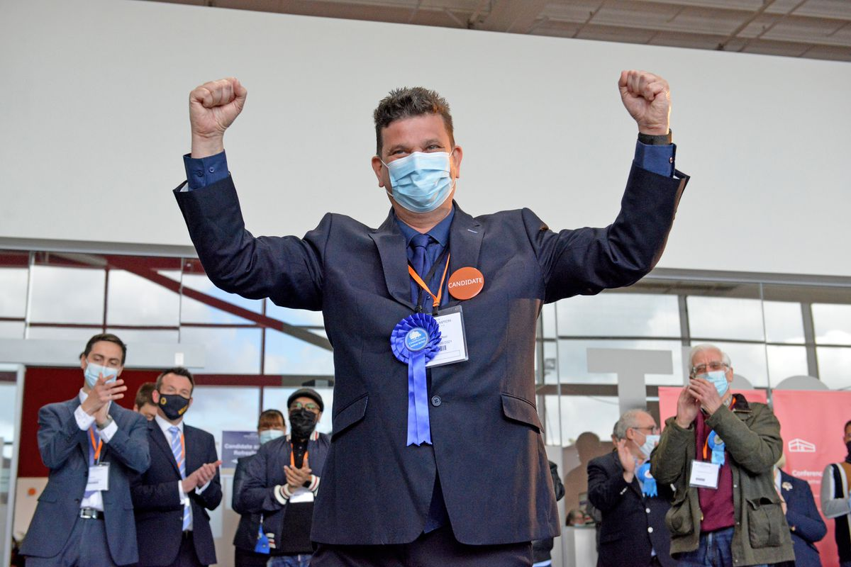 Andrew McNeil celebrates after winning the Bushbury North seat for the Tories