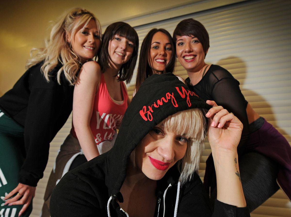 Kimberly Wyatt, during her visit to lead a dance class, with (left-right) Jade Calleja, Michelle Churm, Racheal Cooke, and Inspire 2 Dance principal Emma Dugmore, all of Wolverhampton, at Haden Hill Leisure Centre, Cradley Heath