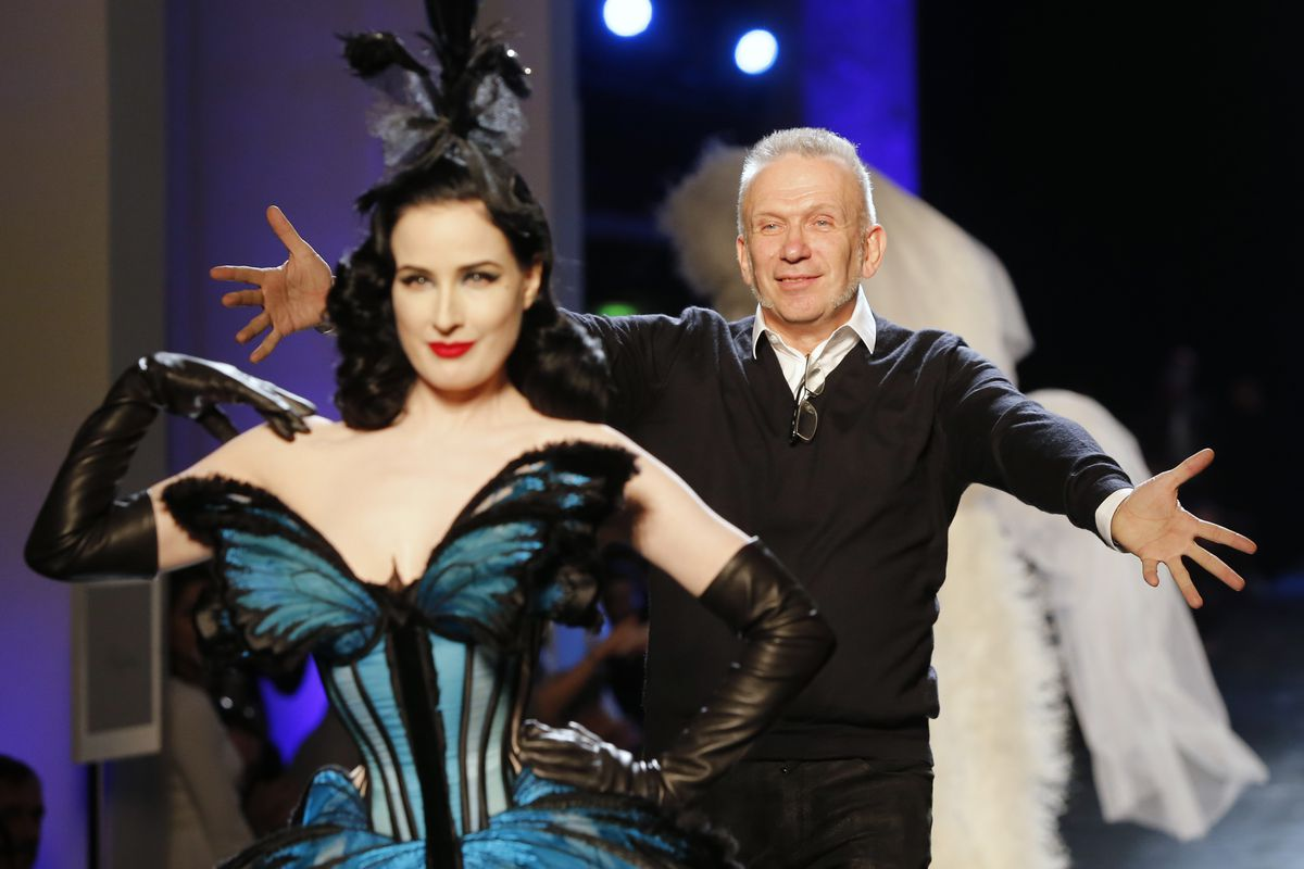 French fashion designer Jean-Paul Gaultier with Dita Von Teese at the end of his Spring-Summer 2014 Haute Couture fashion collection