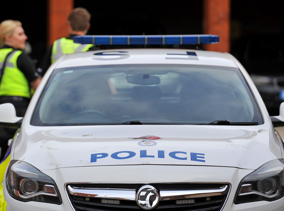 Police officers are investigating after the boy was grabbed in Garratts Lane