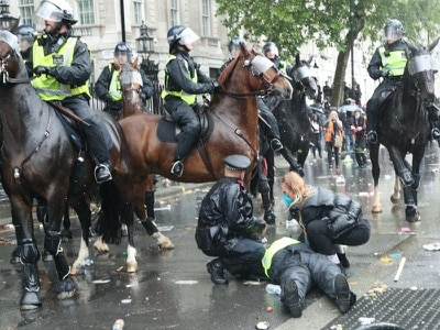 Horse bolts through crowd as police and demonstrators clash at anti-racism rally