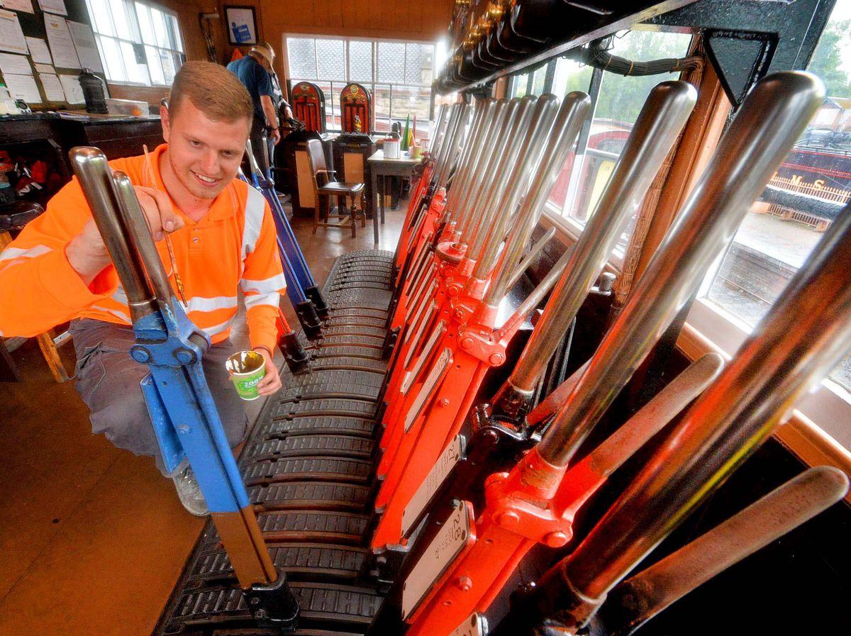 Apprentice Bradley Windridge works on the signal box at Severn Valley Railway