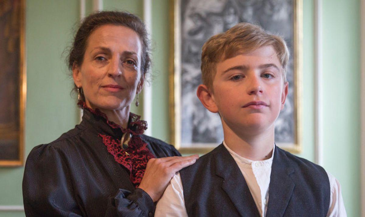 Nicole Ansari-Cox plays Lawrence's mother Sarah