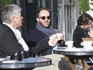 People are seated in a cafe terrace, in Rennes, western France