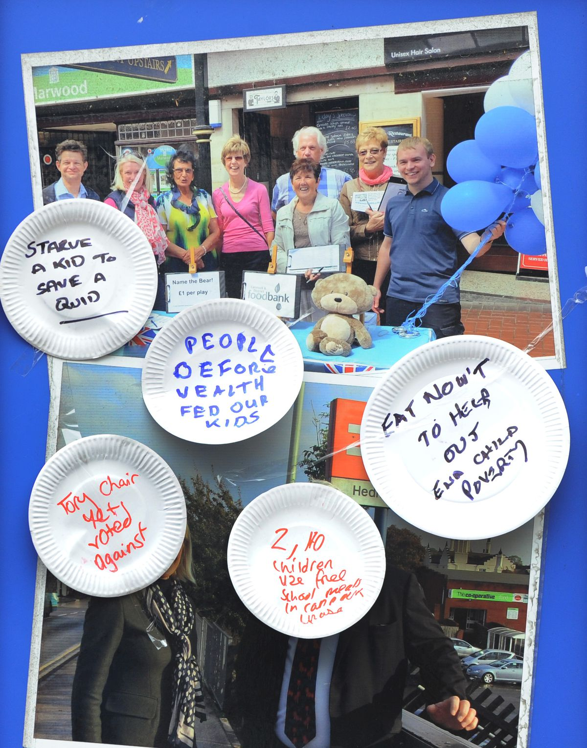 A protest about free holiday meals, outside the office of Amanda Milling MP, at Hednesford, paper plates stuck to the window