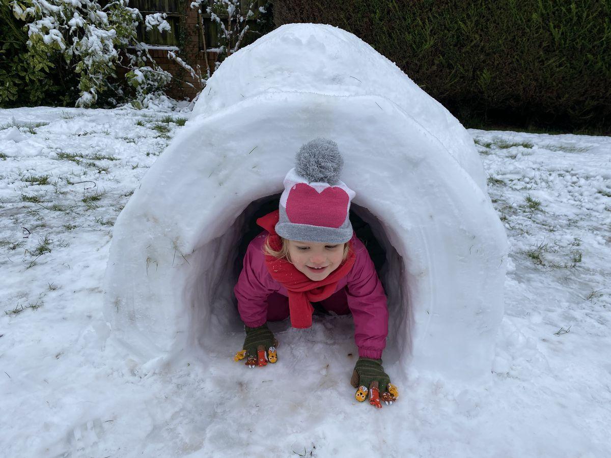 Jasmine Martin enjoys her igloo at her home in Bilbrook