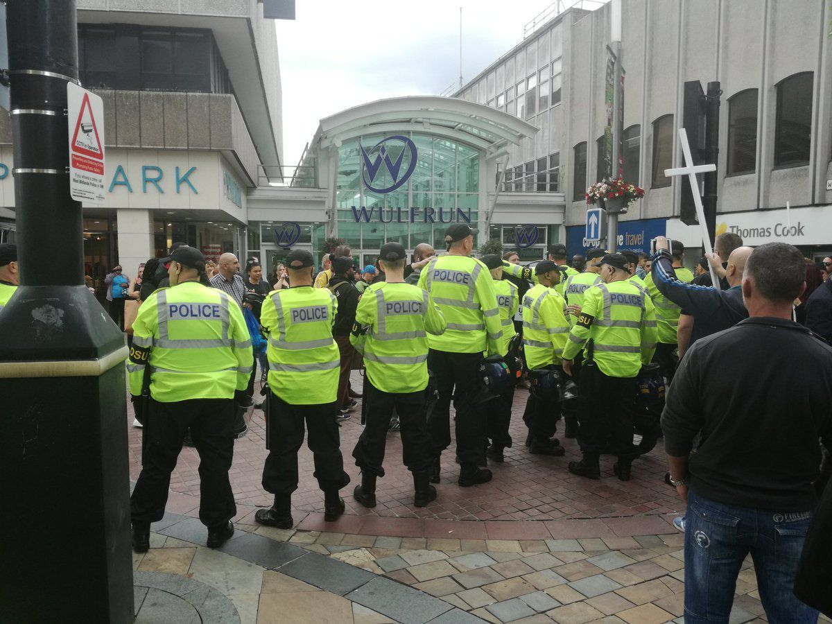 Police officers keep Britain First activists away from protesters in Wolverhampton