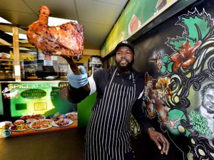 Tony Graham shows off some of his wares at Spice it Up, a Jamaican takeaway in Park Village, Wolverhampton