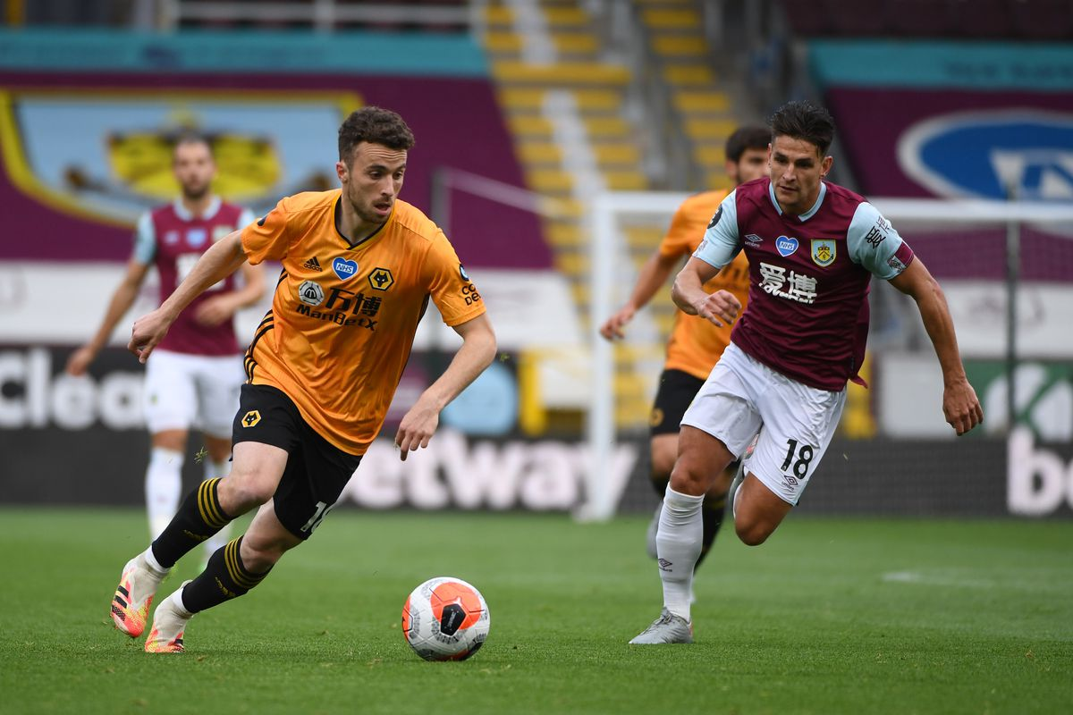 Diogo Jota of Wolverhampton Wanderers and Ashley Westwood of Burnley. (AMA/Sam Bagnall)