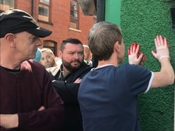 Killed journalist's friends protest outside dissident republican group's office