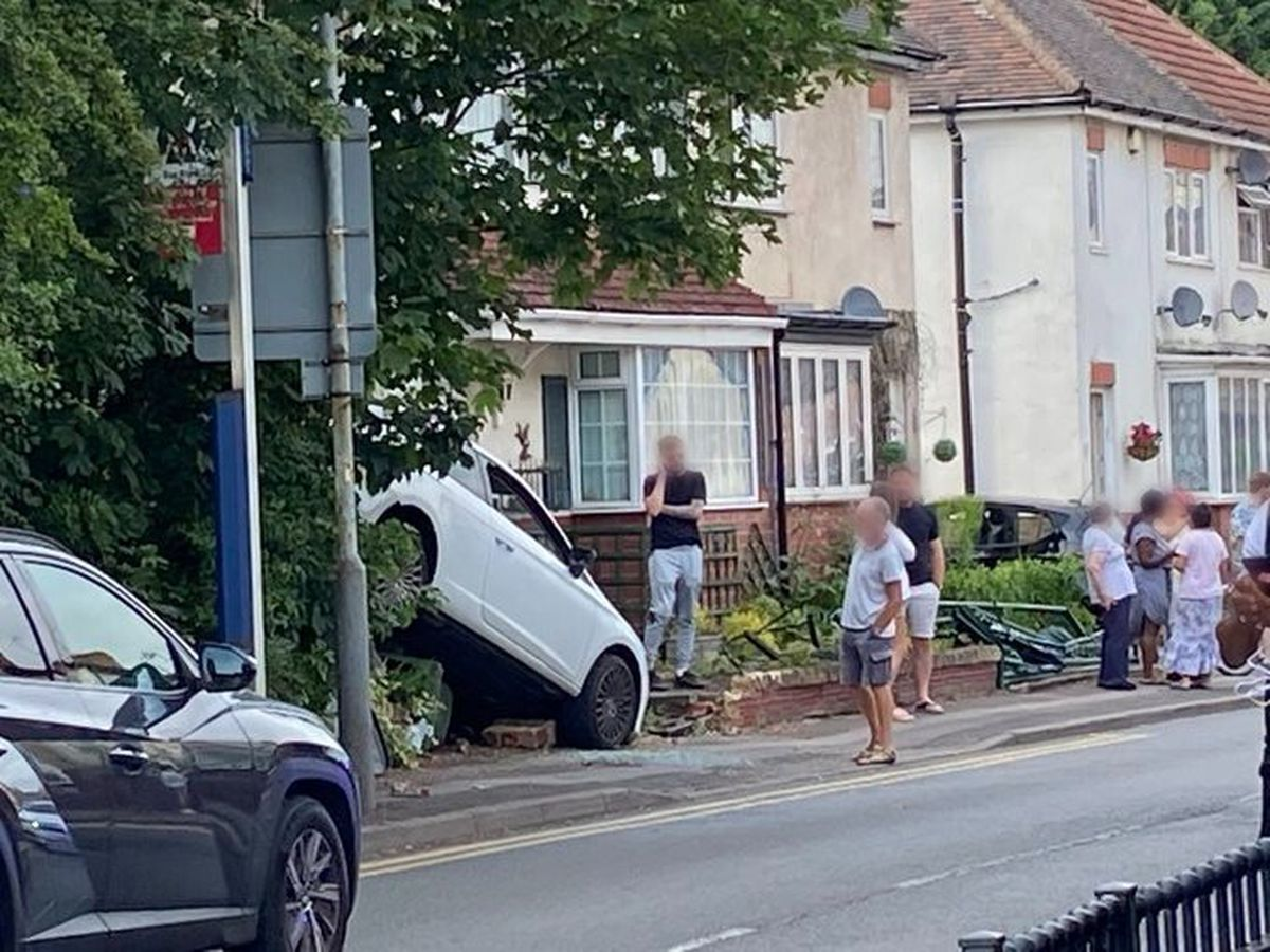 The white Seat Leon reversed into a wall on Aldersley Road, in Wolverhampton. Photo: Si G