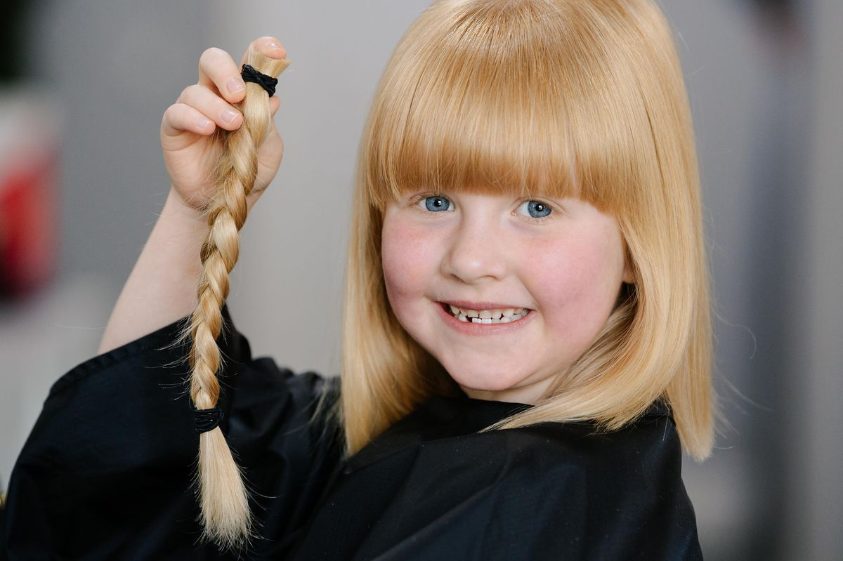 Polly Davis, six, has raised more than £500 for The Little Princess Trust after having eight inches chopped off her hair