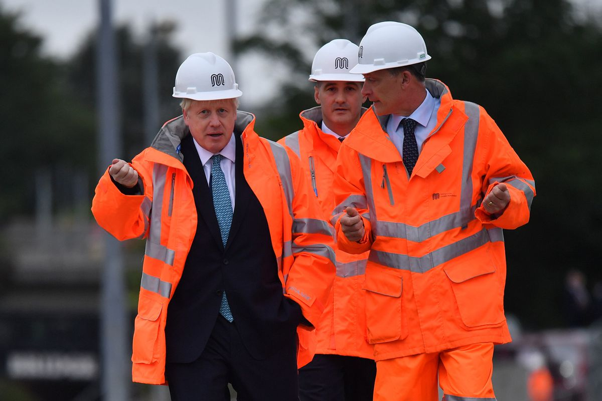 The PM donned a hard hat and hi-viz jacket during a visit to Manchester