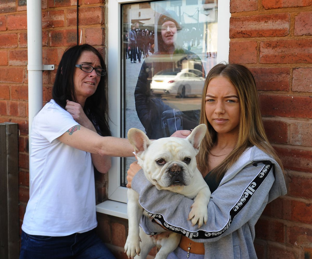 Shane's mother Dawn Bennett and sister Cassie Mayer with the beloved pet dog Porsha outside the family home in Wolverhampton