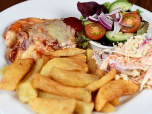 The BBQ chicken was beautiful and came with bacon and melted cheese as well as chips, homemade coleslaw