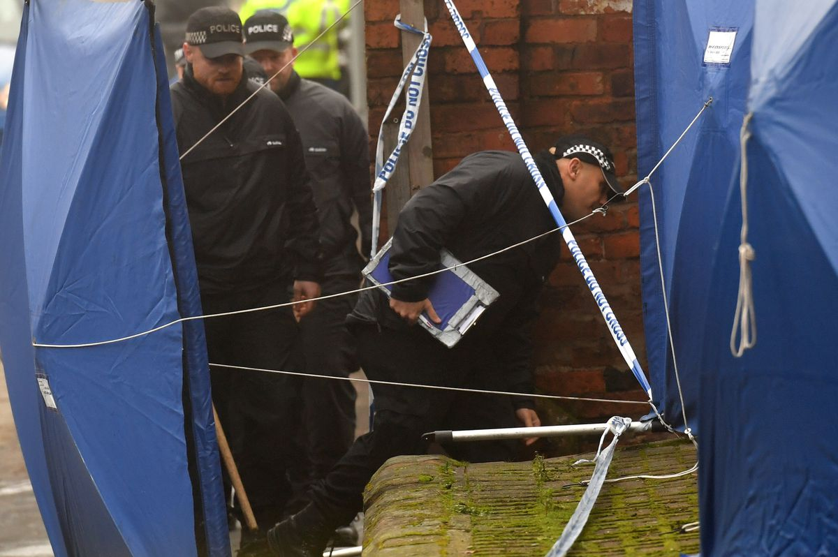 A forensic search team attend the three-storey block of flats in Wolverhampton Road, Stafford. Credit: Jacob King/PA Wire