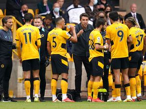 Wolverhampton Wanderers manager Bruno Lage (centre) speaks to his players
