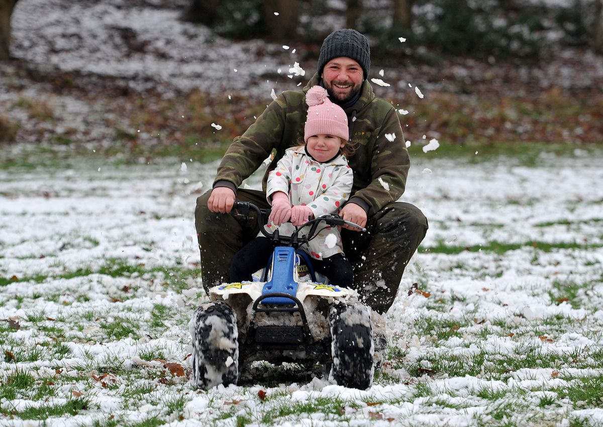 An alternative way to get around in the snow for this pair in Ravenhill Park, Rugeley