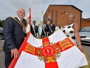 Wolverhampton Mayor Greg Brackenridge and Angela Verley, chair of the Wolverhampton Caribbean Community Memorial Trust, with the Why Are We West Indian Standard Bearers Dennis Litchmore, Kenneth Straun, Vincent Daniel and Patricia Bowen