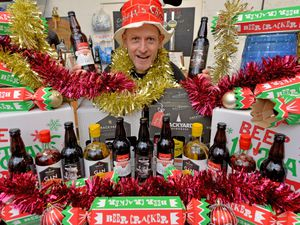 Owner Austen Morgan with their Christmas selections