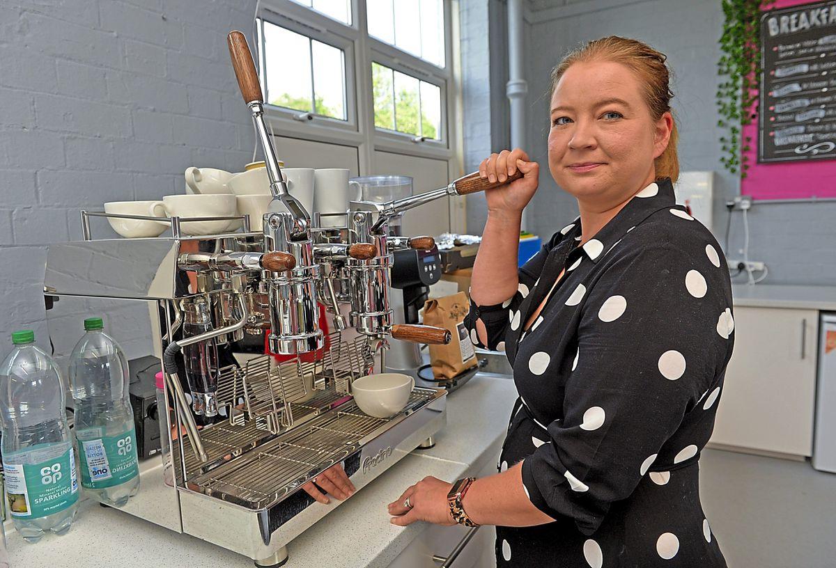 Laura with vintage coffee machine Doris