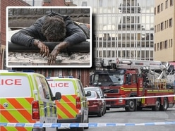 Road closed as police negotiate with man throwing debris from roof in Birmingham city centre