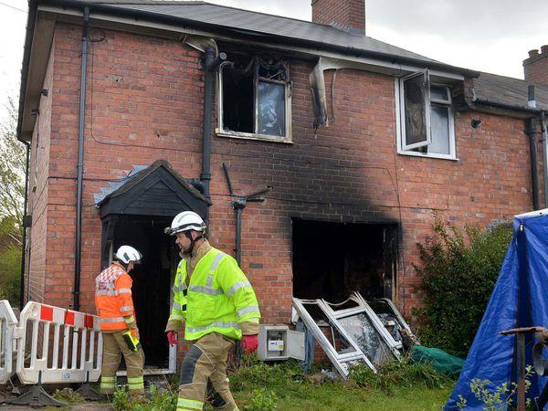 Fire investigators at the scene in Sedgley where a woman died