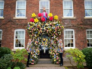 Celebrity hairdressers Nick Malenko (left) and Royston Blythe show off their fantastic Easter floral display on the front door of their home in Bridgnorth