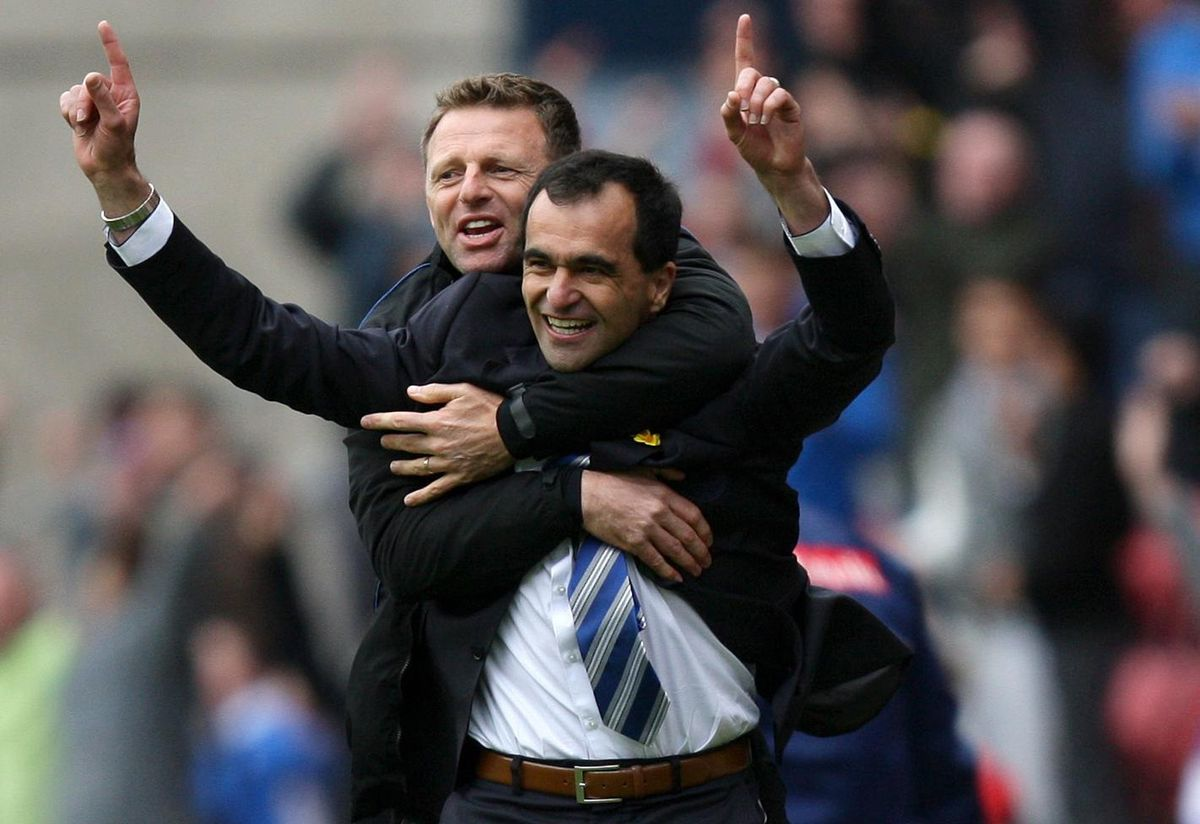 Wigan Athletic manager Roberto Martinez celebrates his sides second goal with Assistant manager Graeme Jones during the Barclays Premier League match at the DW Stadium, Wigan
