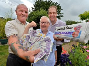Winners Pete and Val Hickman are all smiles as Andy Maxwell, E&S promotions manager, hands over £1,000