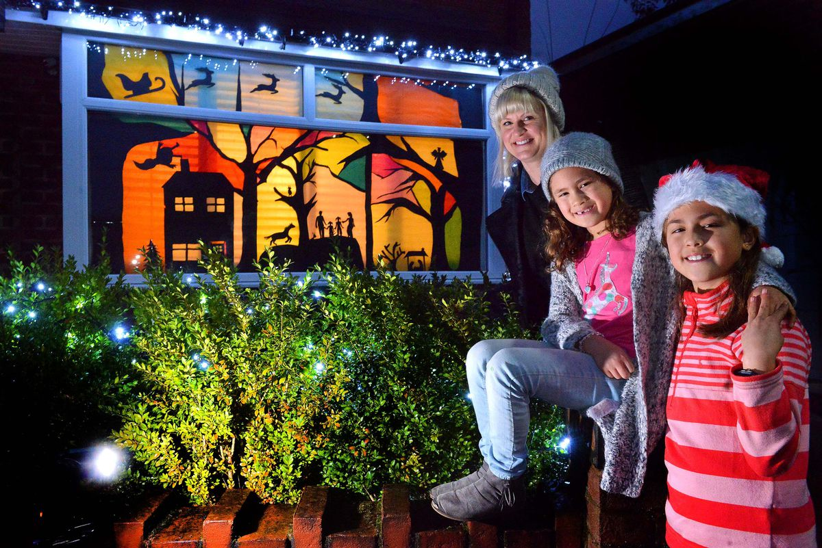 Roseanne Tang and daughters Sophie, six, and Grace, nine, with their display for the Bearwood Winter Wonderland trail