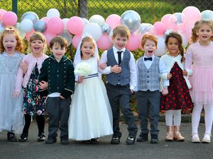 Pictured are 'bride and groom' Phoebe Eades, aged 4 and Joel Wallis, aged 5, and other members of the wedding party