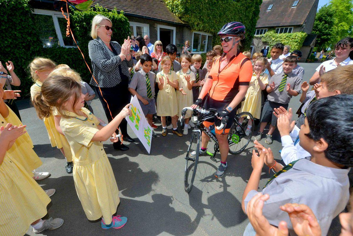 Alexandra Heath is cheered on by pupils