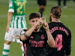 Real Madrid battle to victory over 10-man Real Betis