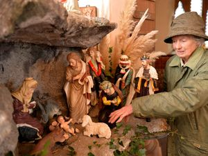 Sue Kennedy prepares the crib display at St Mary's Church, Acton Round near Bridgnorth