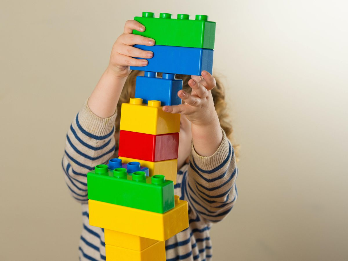 A child plays with plastic building blocks