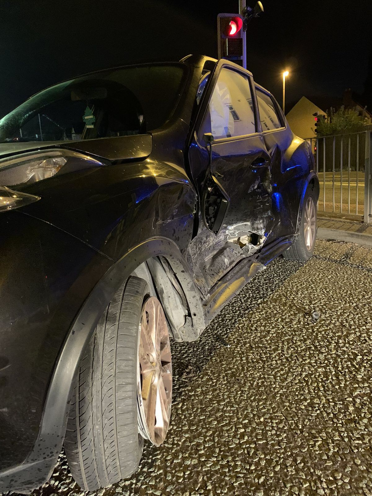 A car's wing was smashed in by the collision.