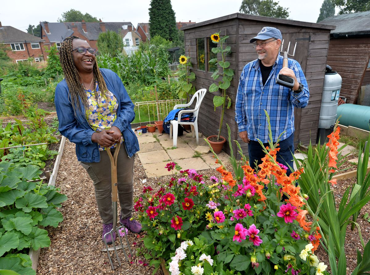Florence enjoys a laugh with Geoff Gooding at Mount Road Allotments