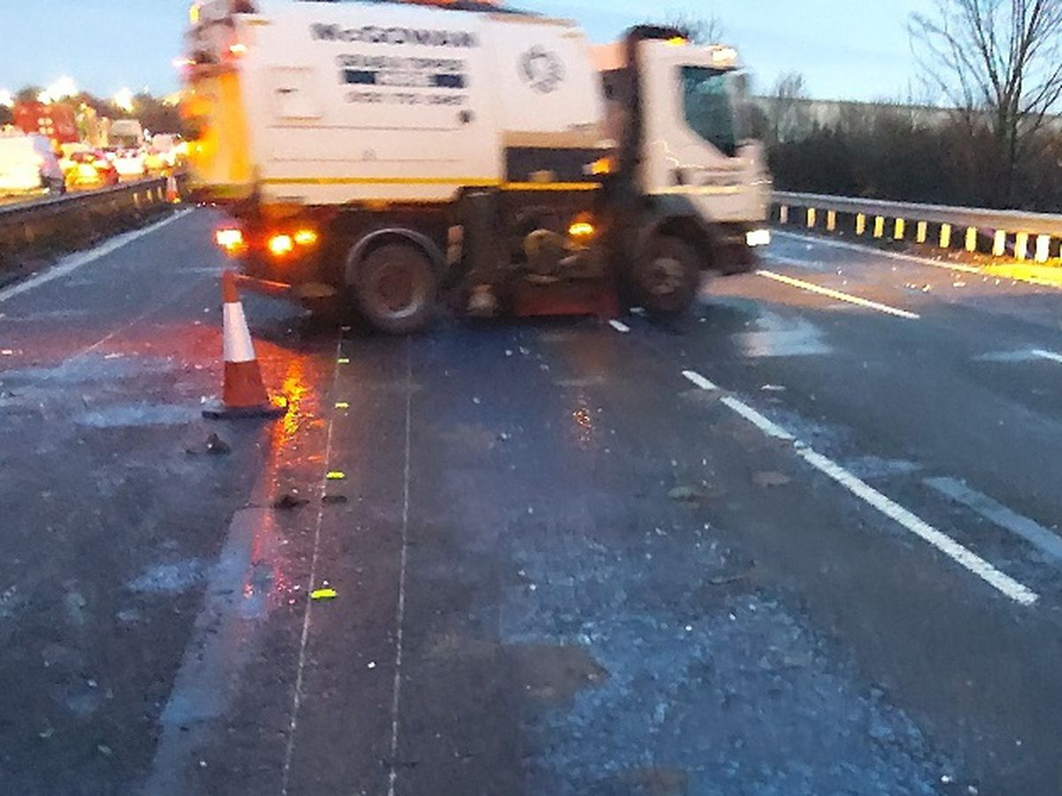 The clean-up operation after a shed load blocked the M6 near Stafford. Picture: Highways England