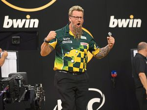 Simon Whitlock enjoys his incredible comeback victory at the Grand Slam     Picture: Lawrence Lustig/PDC