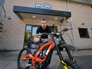 Vince Flaherty, general manager of PCR Performance in Cannock, with a SUR-RON Light Bee bike