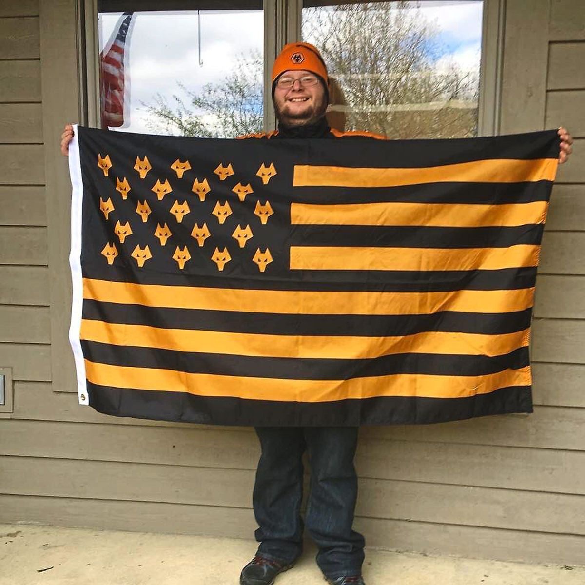 33-year-old Chris Wood, from Columbus in Ohio, with his American Wolves flag