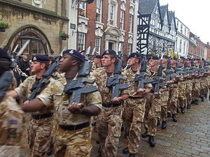 The Staffordshire Regiment march along Bore Street in Lichfield in front of Colonel-In-Chief Prince Andrew, The Duke of York