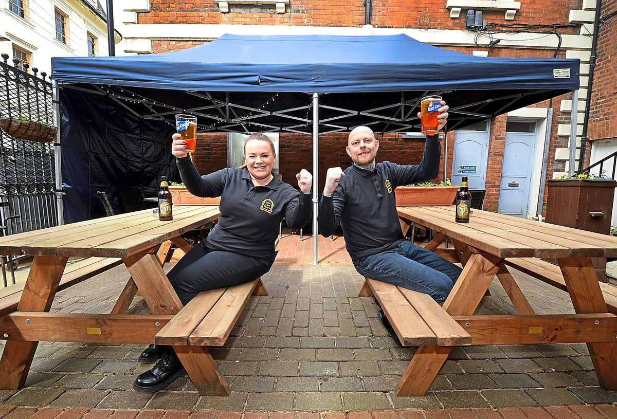 New owners Jo Selman and Martin Cadman of the Lych Gate Tavern celebrate as they prepare for reopening on Monday