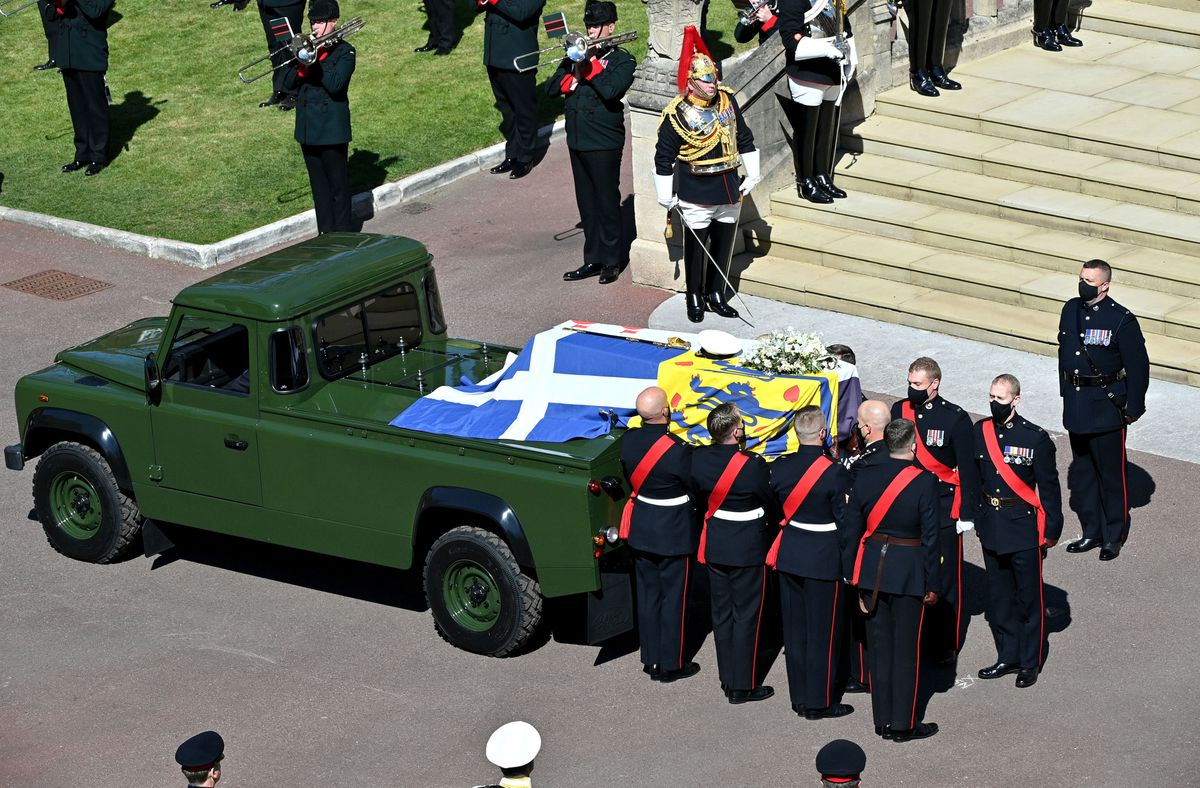 A purpose built Land Rover that Prince Philip helped design carried the coffin along the route