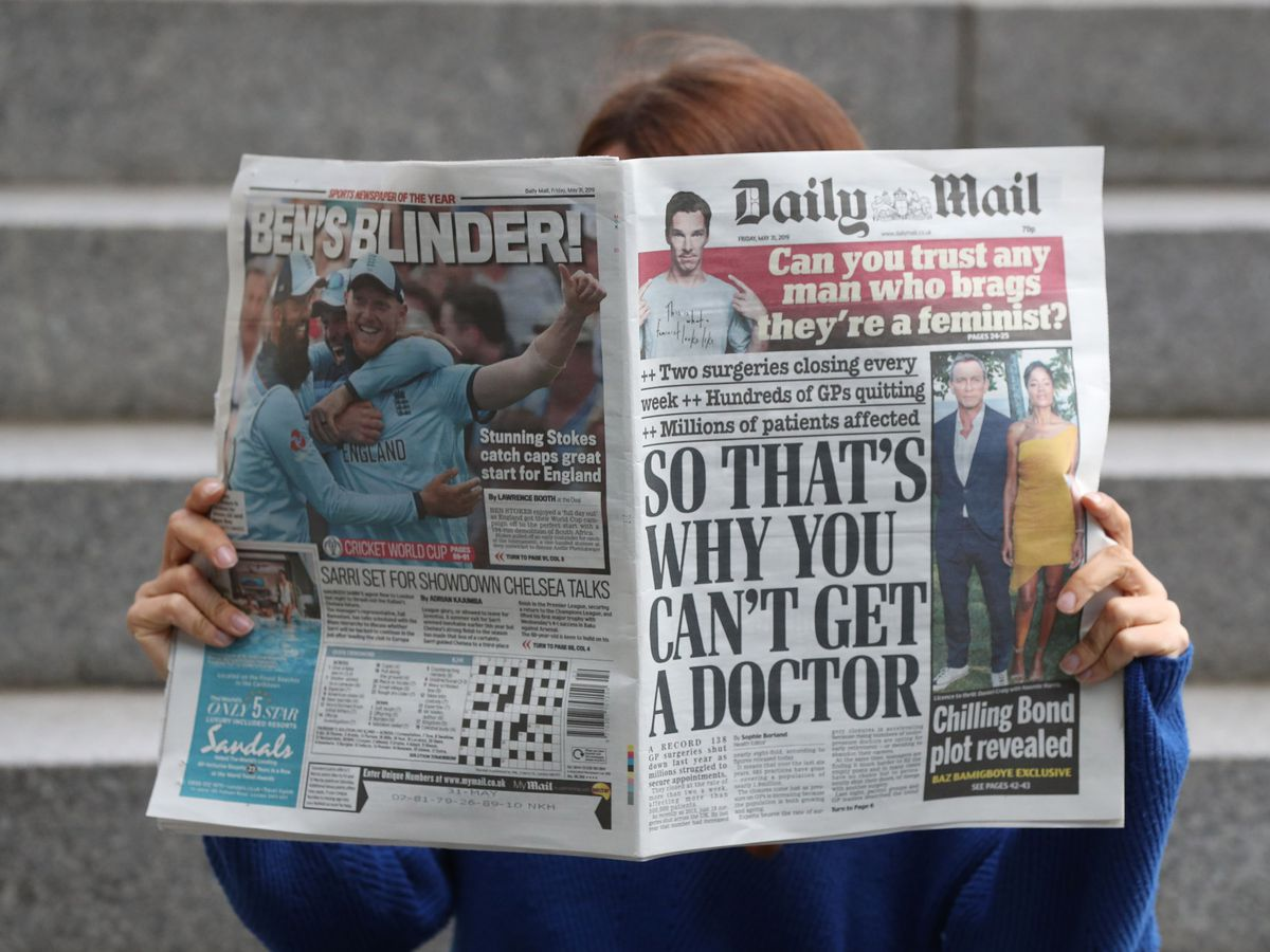 Woman reads Daily Mail
