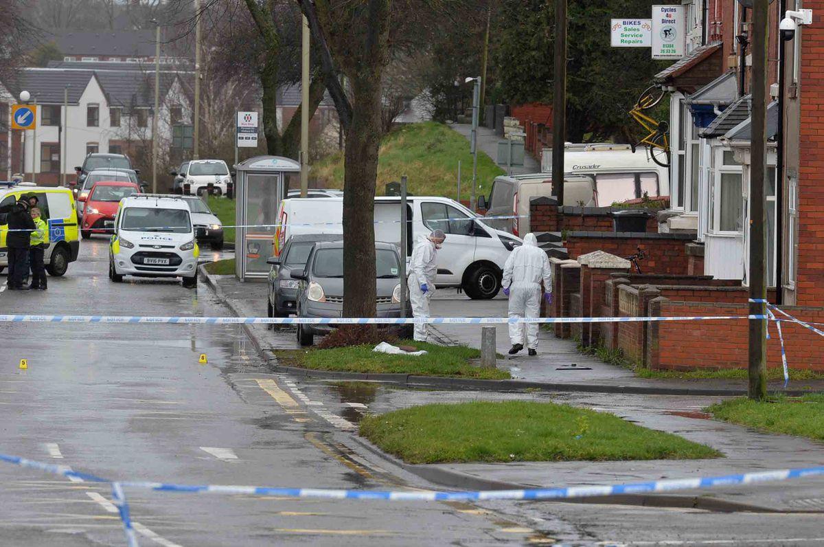 Police forensic teams at the scene on Pensnett Road